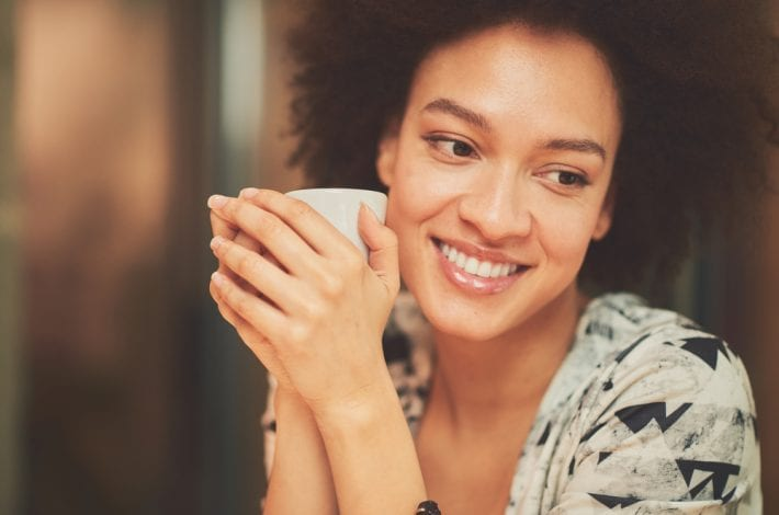 Tips for new mums - mum taking a break with a cup of tea. new mum self-care tips