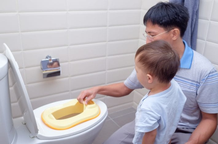 potty training - father talking to son about toilet