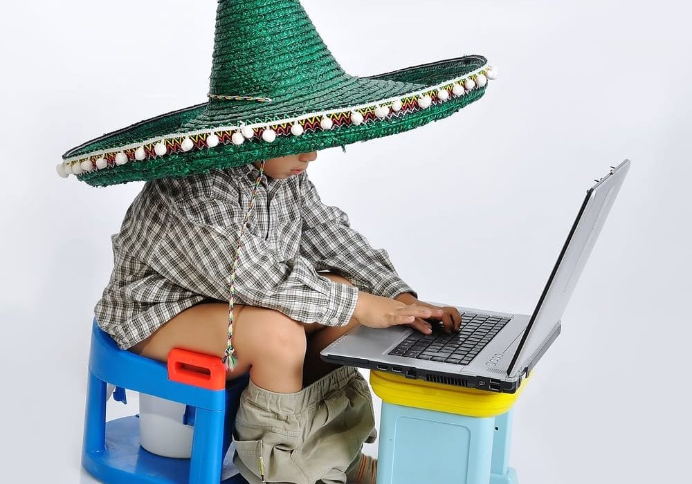 how to potty train - mexican kid on laptop