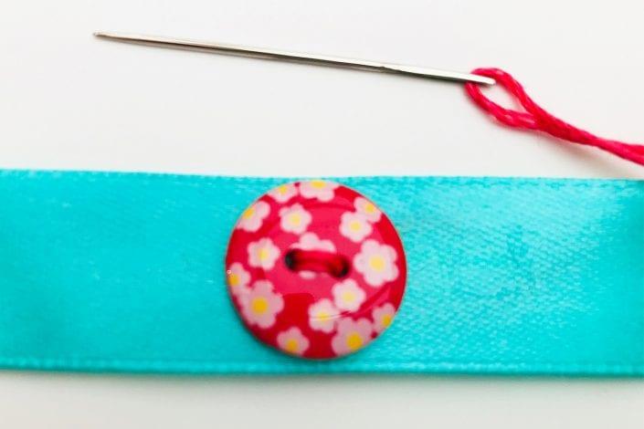 Button bracelet step 1 sew button on