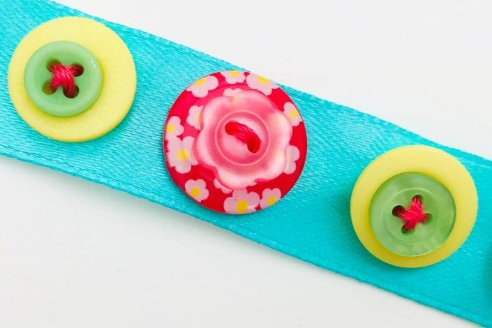 Fun kids craft - button bracelet step 2 layer buttons