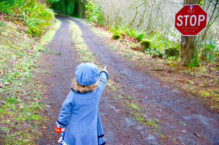Toddler pointing at STOP streetsign - recognising letters
