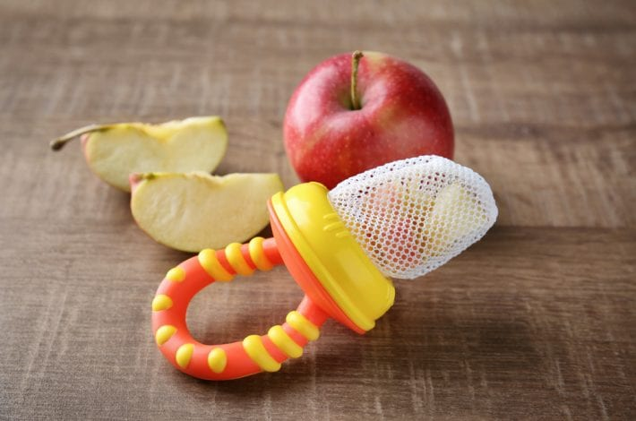 baby teething mesh nibbler with apple chunks
