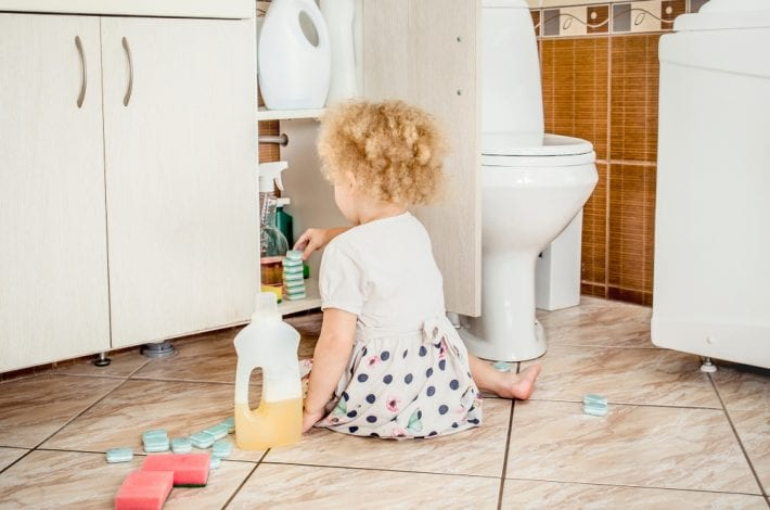 cleaning detergents toddler playing dangerous babyproofing