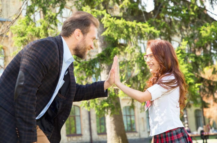 father praising daughter and giving a high five