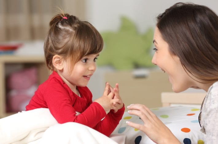mother being positive with young daughter