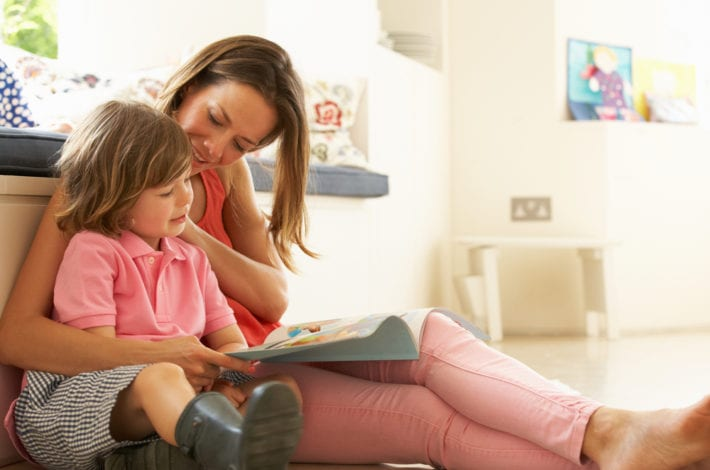 mother reading child a book