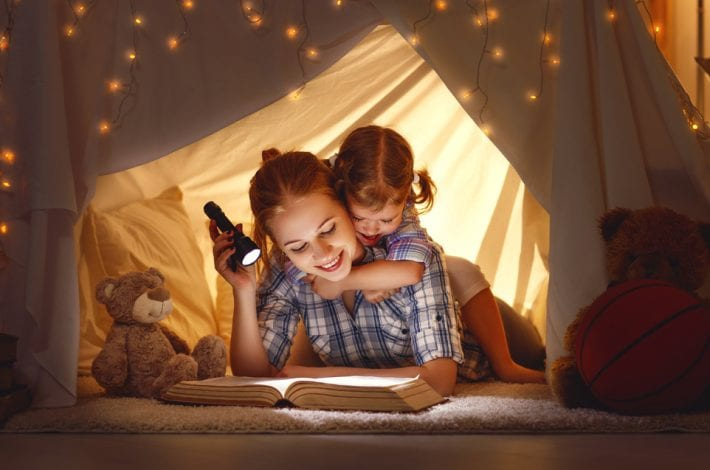 mother reading to toddler in a magic tent - fun ways to learn letters
