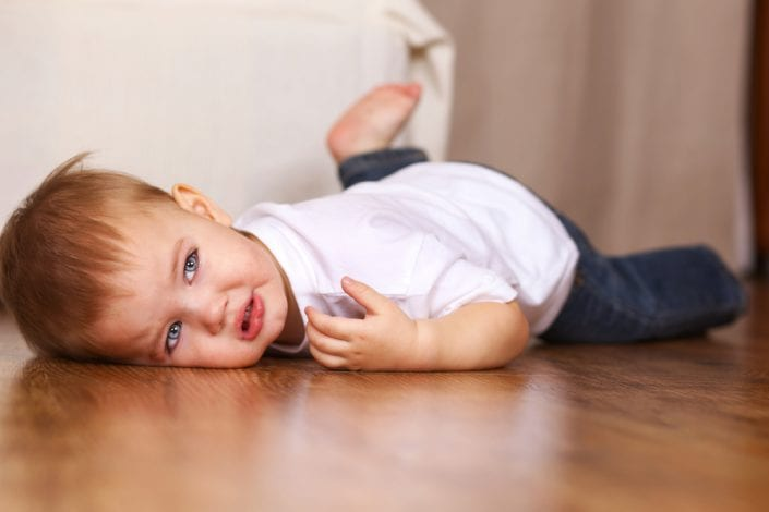 toddler boy having a tantrum on the floor