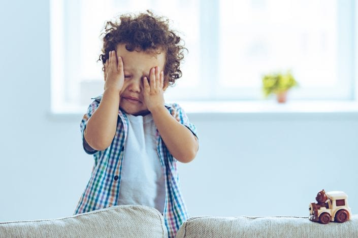 toddler boy rubbing his eyes tired - tantrum