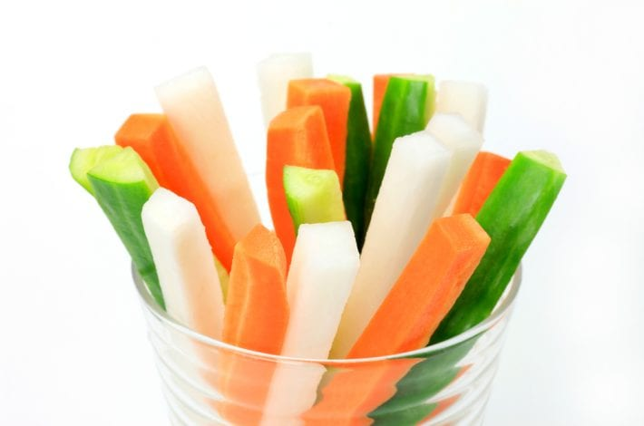 carrot cucumber and celery sticks in a plastic cup