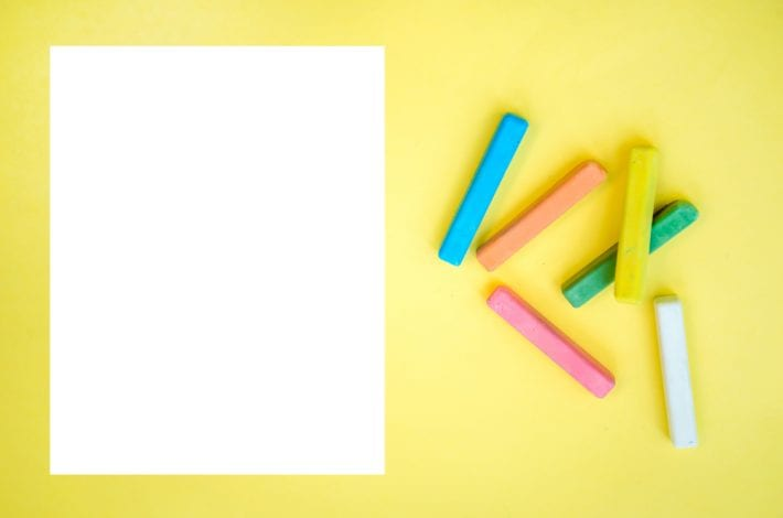 white paper with crayons ready for letters