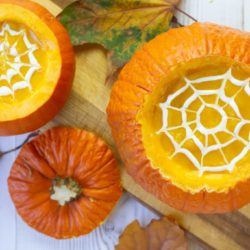 Make this classic squash and pumpkin soup this Halloween - creamy pumpkin soup with rosemary and served in pumpkin shells