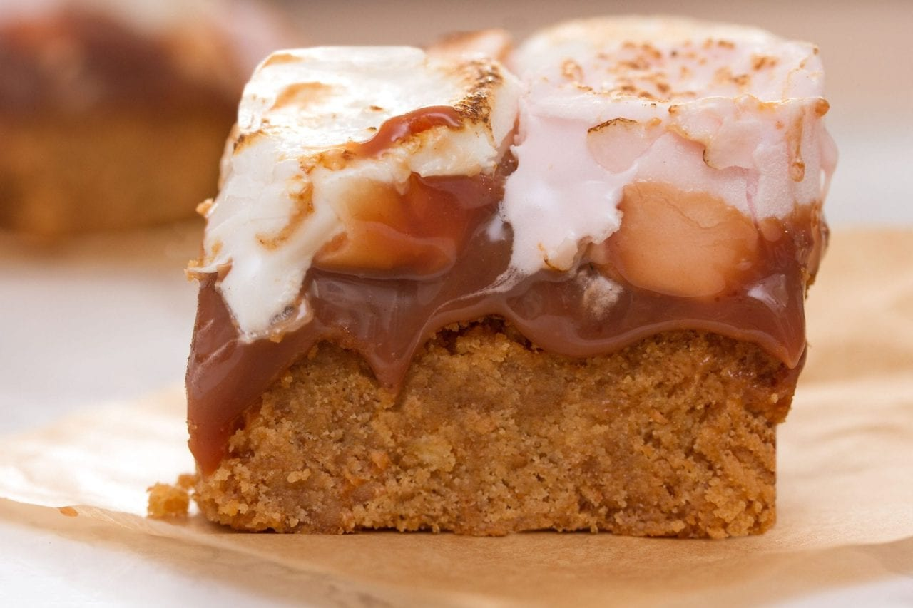 Baked smores bars with an oat base - make these gooey dessert bars for a bonfire night treat