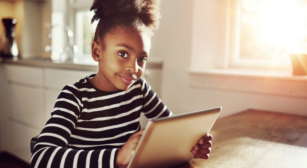 child safe online - young girl surfing the internet
