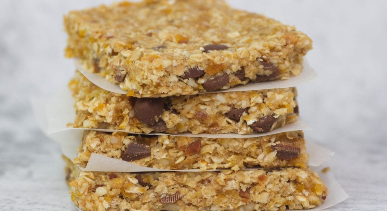 Feel good coconut and apricot granola bars made with hearty oats macadamia nuts and honey