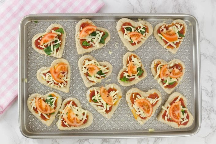 Pizza hearts - try this fun Valentines recipe for kids with these mini pizzas
