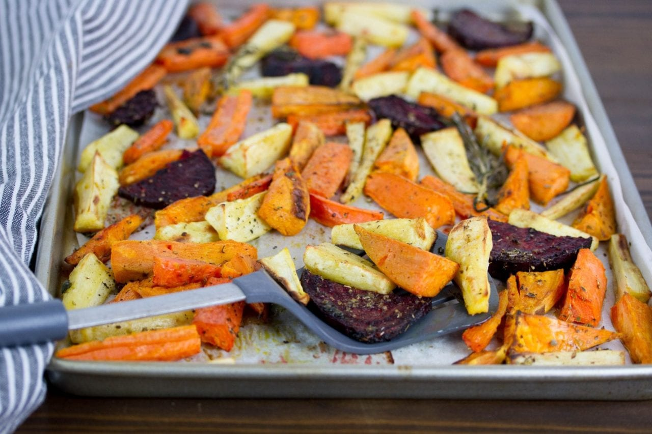 Roast beetroot and root vegetables with fresh herbs - perfect for Sunday family lunch