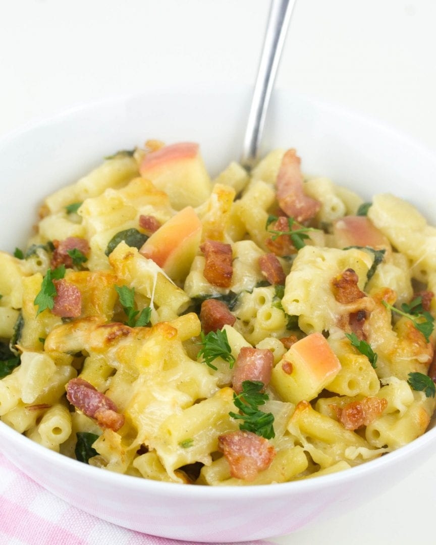 Bacon and apple mac and cheese at its best with slices of apple and a creamy sauce and hidden veggies