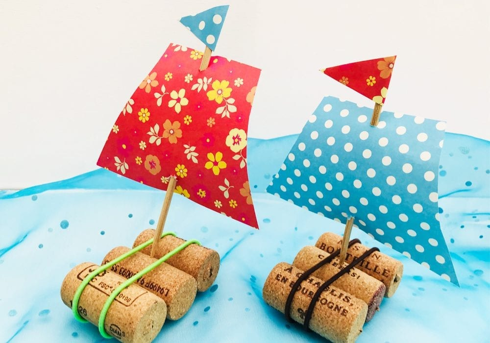 Recycled cork sail boats - make these floating cork boats this year as a great spring or summer craft for kids.