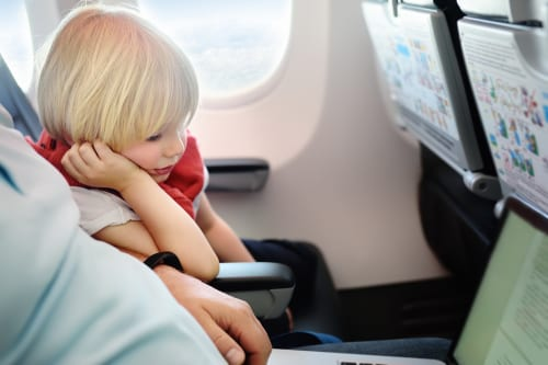 how to make travelling with toddlers on a plane easy - 12 tips to help you travel with kids