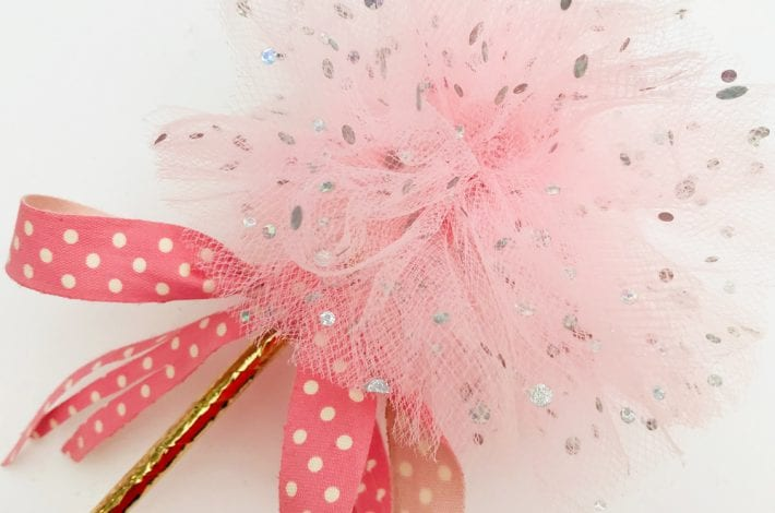 DIY princess party decorations - learn how to make tulle pom pom wands. Arrange tulle pom pom sticks in jars or as table decorations at kids parties.
