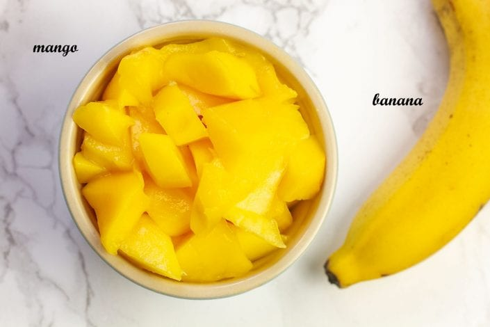 Mango and banana puree - great first foods for baby blended into a puree