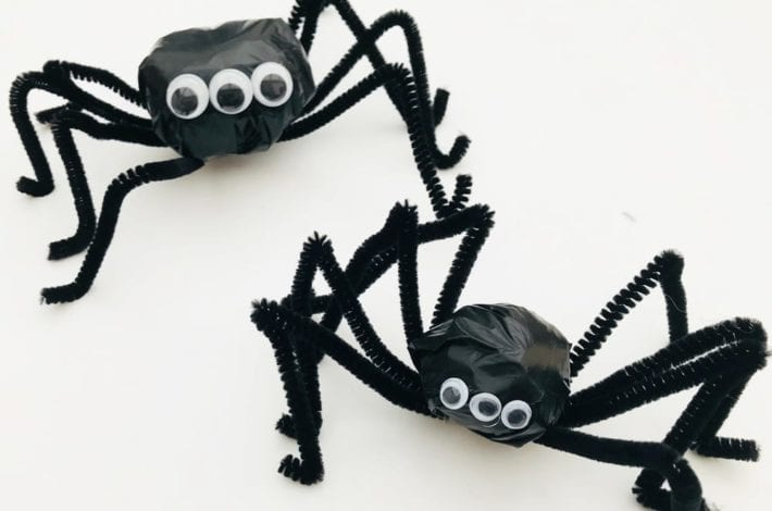 Make these spooky spiders out of the humble trash bag - a great Halloween spider craft for toddlers and kids to enjoy