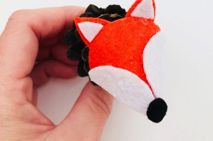 Make this pinecone fox as a great Autumn craft for kids. It's a quick and easy pine cone craft that kids will love this Autumn.
