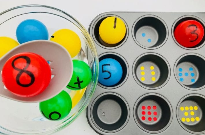 Make a fun number recognition game with these colourful balls. Fish out each number and match it to the right number of dots in the muffin tray.