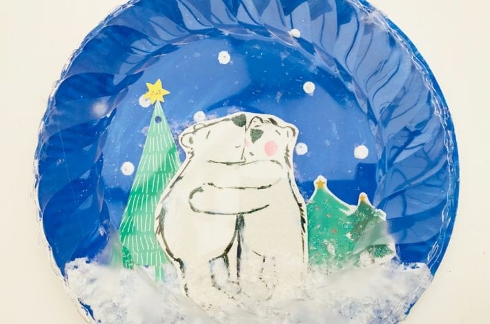 how to make clear paper plate snow globe crafts - a quick and easy Christmas craft to enjoy with kids that's just magical
