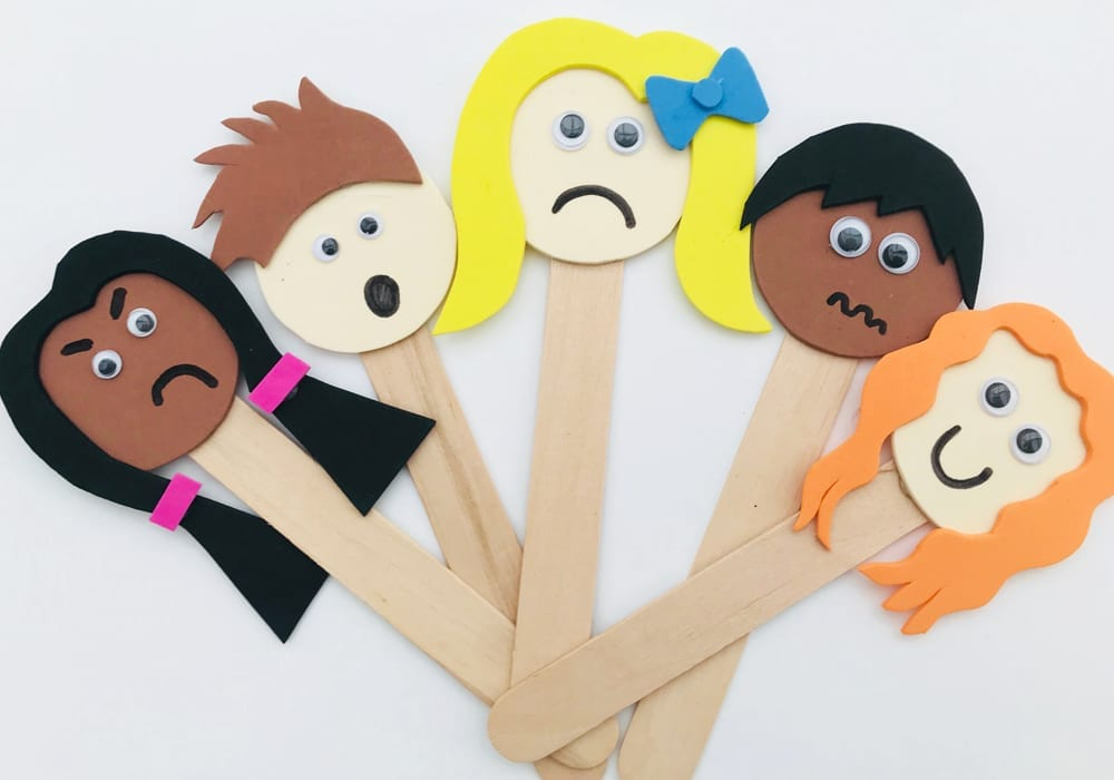 Popsicle emotion puppets - Social emotional activities for preschoolers - explore emotions with your toddler