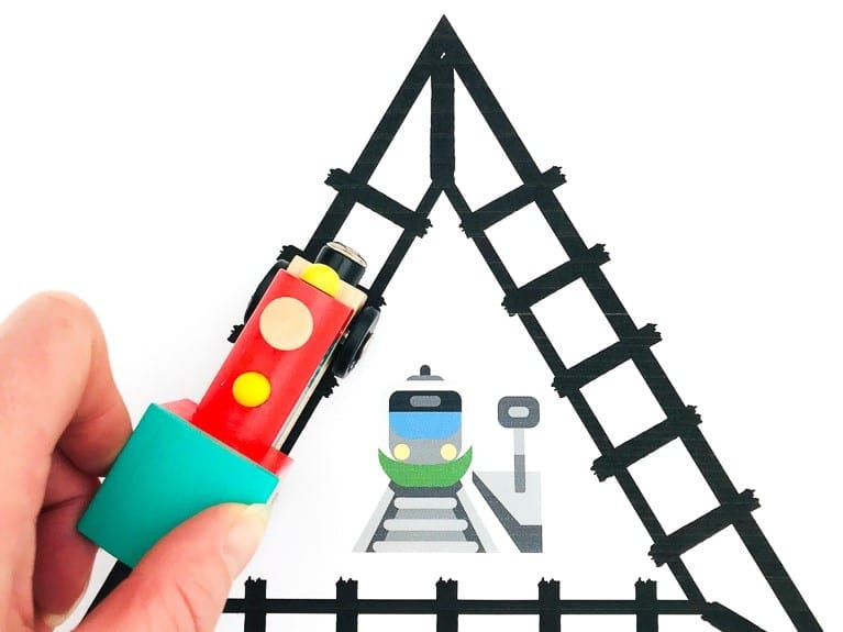 Learn first shapes with these clickety clack train track printables for early years - great shapes activity