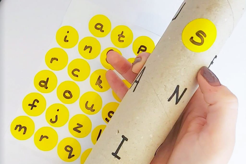 Letter matching activity - match lower case to upper case letters using cardboard rolls - easy learning activity for early years