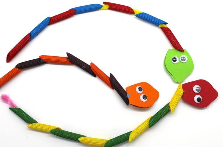 make diy jungle threading pasta snakes - fun kids activity - indoor toddler activity